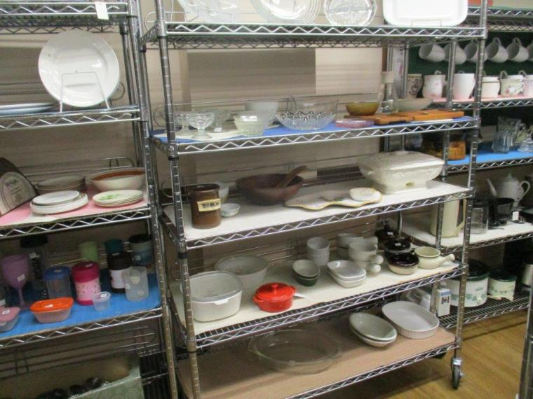 Thrift store shelves with bowls and other dishes