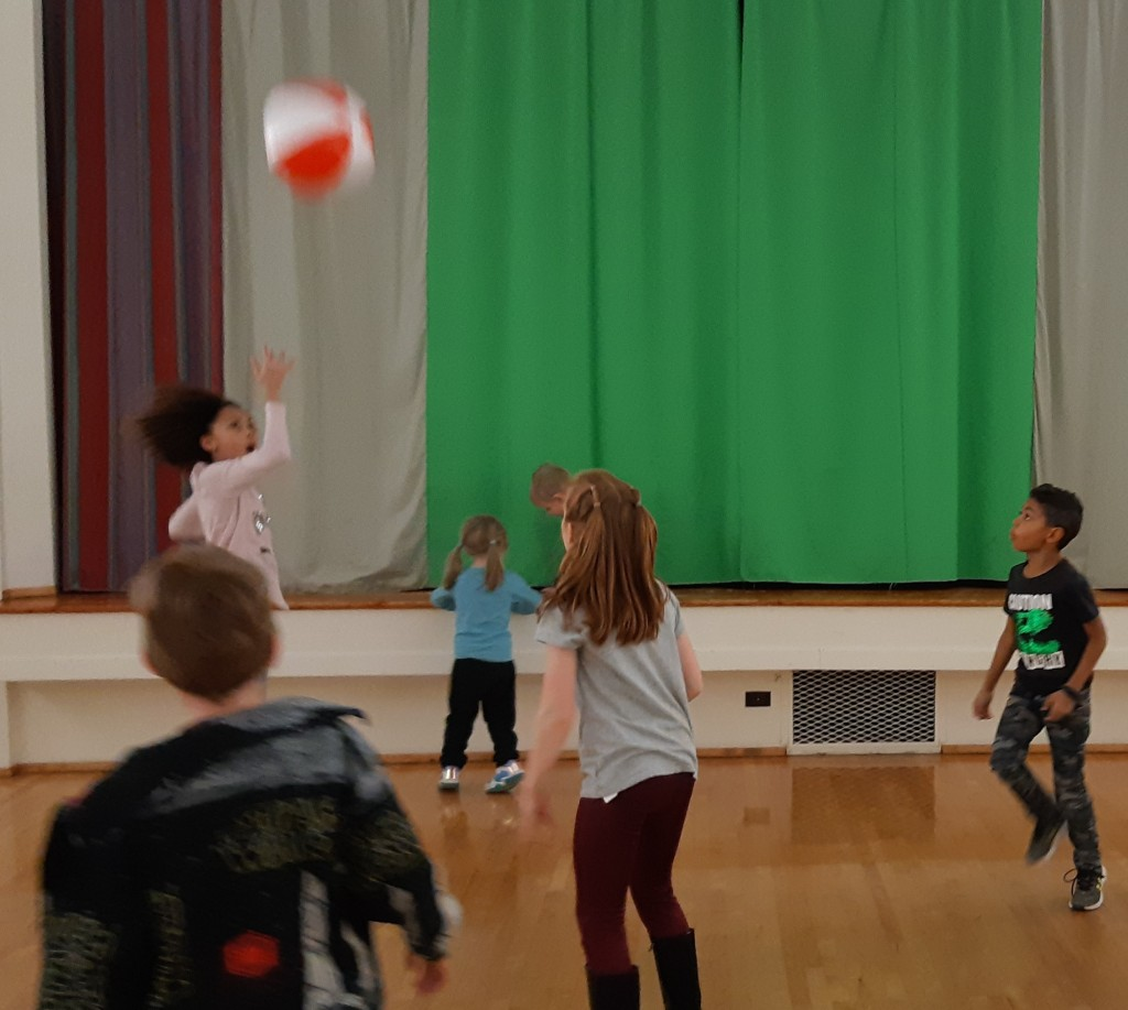 Children playing with beach ball