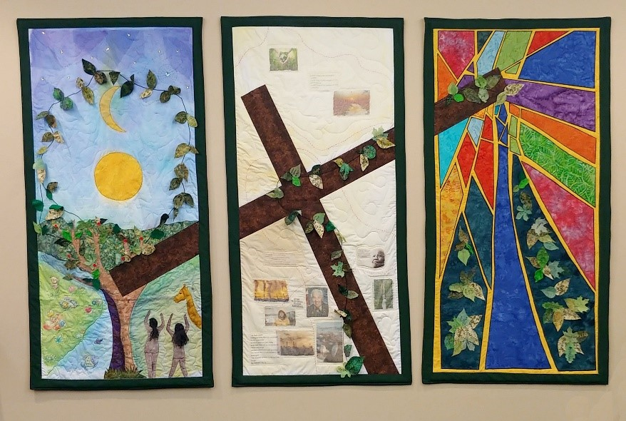 Wall hanging showing cross, Adam and Eve and stained glass.